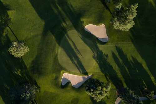 overhead view of golf course and bunkers